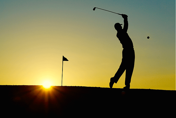 a golfer, symbolizing the idea that you should never quit like Tiger Woods