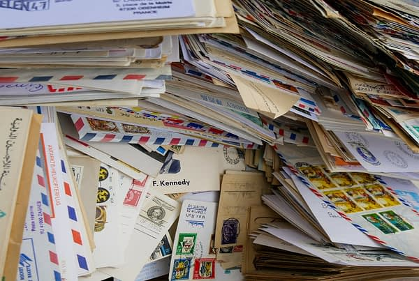 a pile of unopened mail from the mail bag