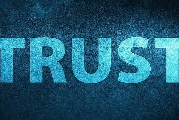 the word trust in big blue letters