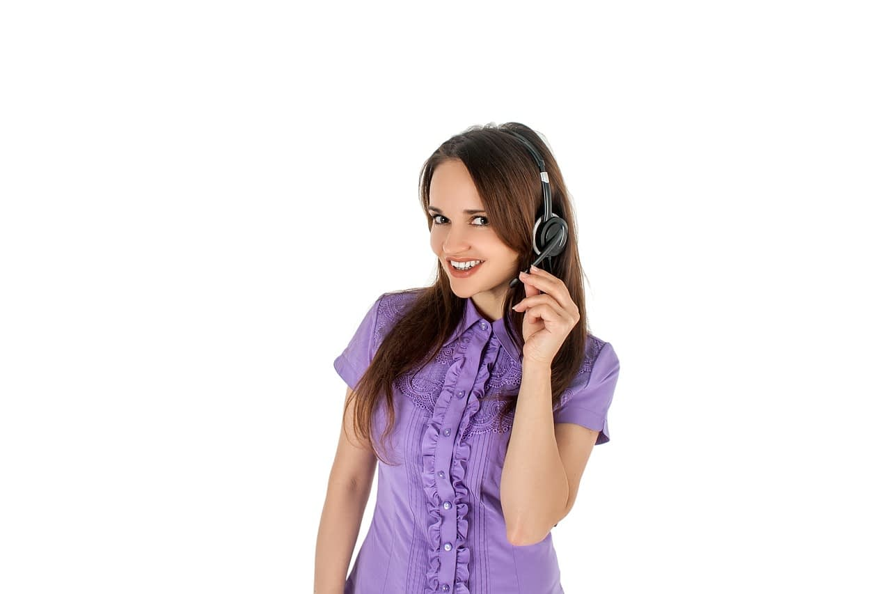 woman wearing headset answering a phone call