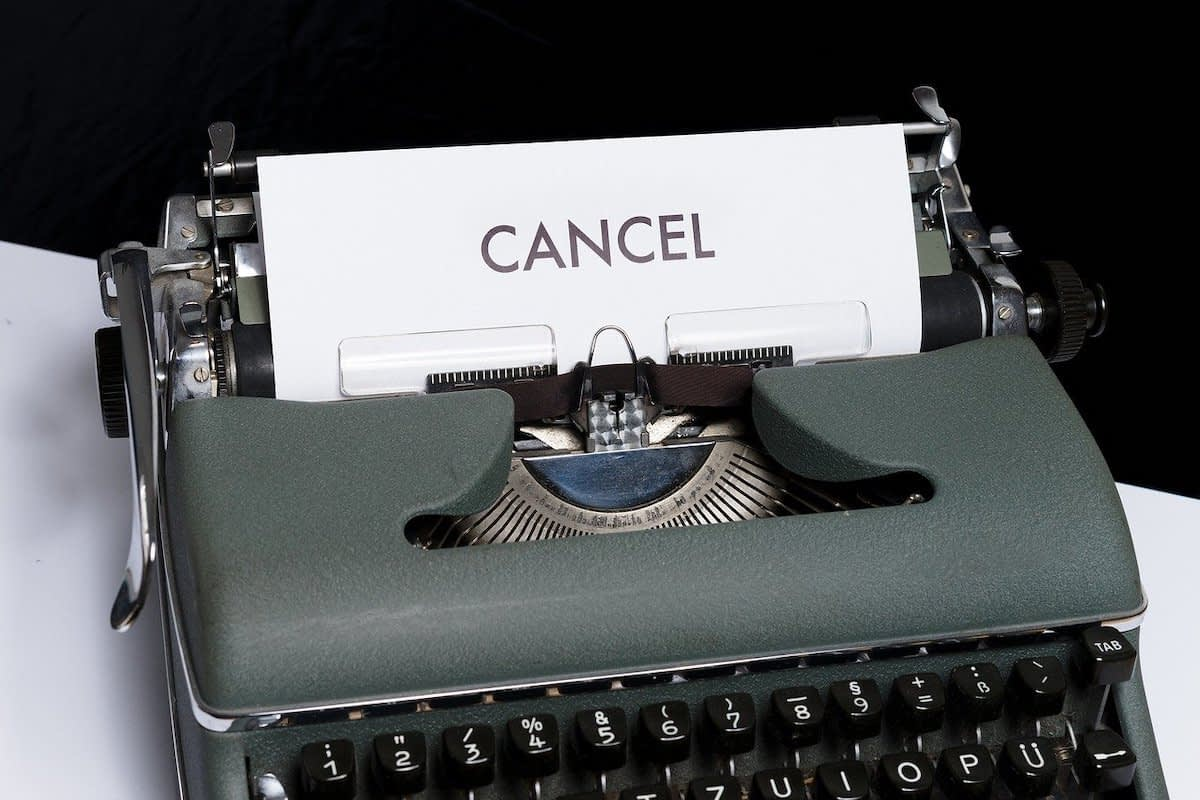 typewriter with the word Cancel written on the paper