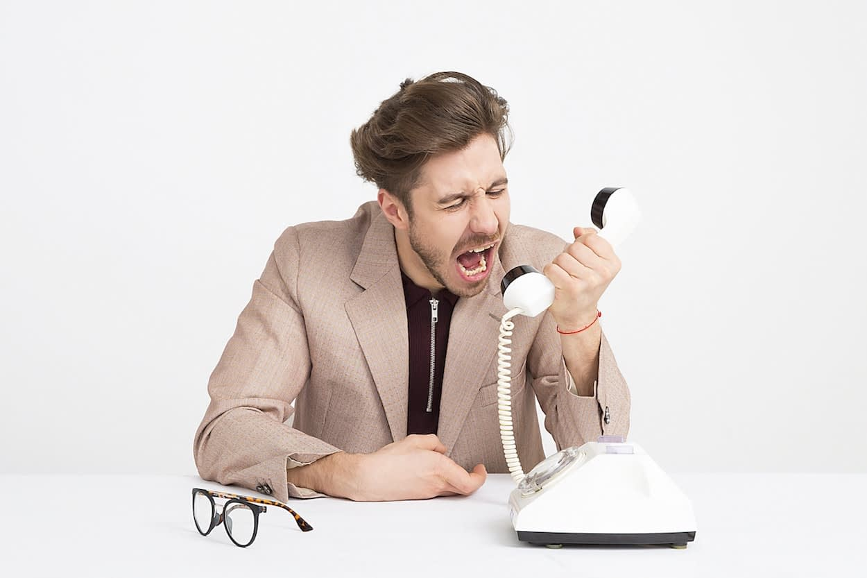 angry man yelling into a phone